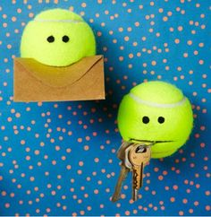 """By: Rae Friis   Using a sturdy box cutter, cut a """"mouth"""" 2-inches wide into the tennis ball. If you're making this for a kid, hot glue a set of googly eyes above the mouth. Fill the hollowed ball with loose change and throw into your purse, tote or gym bag as a traveling buddy.  For a more stationary solution, using a nail or knitting needle, poke a hole through your tennis ball, attach a suction cup, and hang it on the wall. Stick keys, change or cards in the mouth so they don't get lost."""