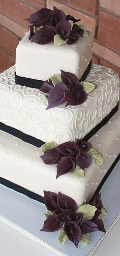 CAKE flower accents: this is a little too small. I want one per tier. My cake is 3 square tiers. Having them exactly at the corners like this is too OCD for me. Should be same flower types as used in my bouquet - with succulents.