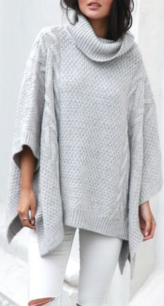 Grey cable knit poncho with white skinny jeans
