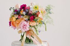 The bright pops of color give a whimsical feel to this bouquet by Lindsay Colette Designs. The vibrant arrangement includes poppies, ranunculuses, peonies, scabiosa, anemones, lisanthuses, garden roses, and alliums.