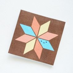 Print out these mini quilt block cards, and use them to hold sewing needles!