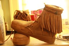 Minnetonka Fringed Sheepskin Lined Tramper Boot from Tribal Impressions- Warm in the winter! Three colors- we have your size- matching fringed handbags! Review the collection off of: http://www.indianvillagemall.com/mocs/trampersheepskin.html
