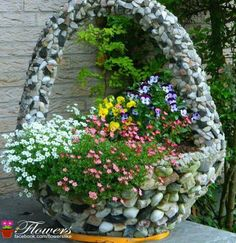 Rock basket as a container. Cover wicker basket with small rocks using mastic glue.