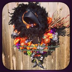 Custom witch is in ribbons and burlap mega wreath for my 2014 Halloween decor for the front door. Custom Wreaths by Bethany Arriola