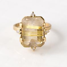 "Have you seen our rutilated #quartz statement rings? This one is on sale! Accented with four conflict-free white diamonds, this quartz ring is made in solid 14k yellow gold. The golden angel-hair streaks across the stone are beautiful natural striations in the rock, so this stone is definitely the only one of its kind! Click the link in our profile to shop, and search ""quartz"" ⭐️"