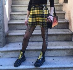skater skirt, tights, and doc martins. Perfect grunge street style