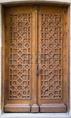 Medieval intricately carved door on a building in Toledo, Spain Stock Photo