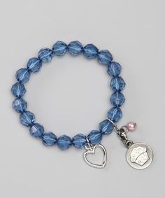 This Blue Two-Tone Cupcake Stretch Charm Bracelet by Sugar & Vine is perfect! #zulilyfinds