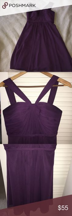 This classy Plum (bridesmaids) dress In perfect condition. Wore happily for half a day. This dress would compliment just about any occasion. David's Bridal Dresses Midi