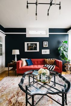If you get a sense of déjà vu when looking at Julia Goodwin's gorgeous blue living room, it's because you've seen it before. A ye...