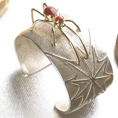 Navajo Sterling Silver and 14kt Gold Spider Cuff with Coral Jewelry