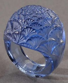 Lalique 1932 'Bouton De Fleur' Ring: dome-shaped blue glass covered with a repeating small flower design.
