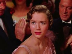 Debbie Reynolds as Kathy Seldon    Ladies and gentlemen, stop that girl. That girl running up the aisle, stop her! That's the girl whose voice you've heard and loved tonight. She's the real star of the picture. Kathy Selden!  Don Lockwood, Singin' in the Rain (1952).