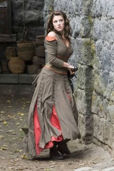 Note the multiple lacings on the overskirt, and the flipped over sleeve caps. This is from Robin Hood the BBC TV series