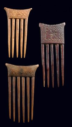 Africa | Three combs from the Baule people of Cote d'Ivoire | Wood, brown patina