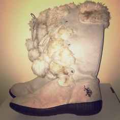 Polo Boots Beautiful polo by Ralph Lauren winter boots only worn once in excellent condition. Foe-fur on top and down the front with two tassels. Polo by Ralph Lauren Shoes Winter & Rain Boots