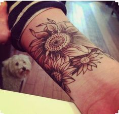 Wrist sleeve tattoo. Would love one with Sunflowers & an Owl.