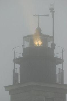 Closeup of Beavertail Light, Jamestown RI in the fog.