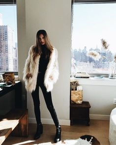 Cute faux fur jacket over all black.
