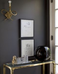 dark grey wall and brass console table