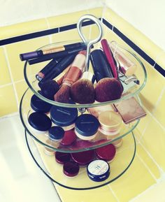 Save counter space and use a tiered platter to store and organize your makeup--better than a drawer because you can actually see what you're working with.