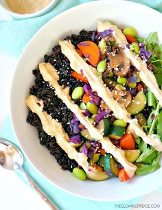 Forbidden Rice & Veggie Glow Bowl. Vegan & gluten free. A nutrient-dense powerhouse bowl with vibrant, sautéed veggies & a creamy lemon ginger tahini sauce.