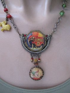 RESERVED Under The Bigtop ... vintage repurposed circus assemblage necklace. $64.00, via Etsy.