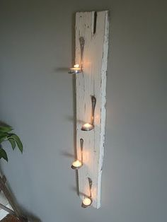 DIY Tealight Spoon Holders - Super chic, great way to recycle old spoons, indoor or outdoor decor, etc. Flip the spoon 18  OMG.... OK... I have a shed... time to paint it... a fold down shelf made of old shutters and these wood and spoon tea light candle holder on each side of the shelf... OH THE IDEAS ARE SPARKING