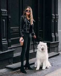 All black outfit with a white somoyed dog