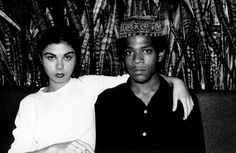 """Who: Jean-Michel Basquiat and Suzanne Mallouk Known for: He electrified the downtown art world with Expressionist paintings that incorporated graffiti and African motifs; Mallouk, his muse or the """"Widow Basquiat"""" as she is referred to in a recent memoir by Jennifer Clement, was loyal through the painter's short and eventful trajectory. The downtown gal with a Sphinx-like beauty met the painter when she was working as a bartender at a dive bar. The Look: Her dark-eyed exotic beauty…"""