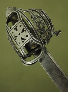 Massive 18th c. Scottish baskethilt horseman's sword Very nice sword made during the early 18th c. Jeffrey's blade. Thick steel hilt decorated with pierce work and chiselled details.