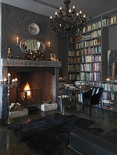 Gray and black library with chandelier. Michael Paul Photography