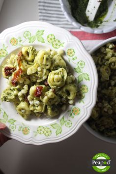 Tortellini Pasta Salad with Basil Pesto, Corn and Sundried Tomatoes from @KeystotheCucina is a great little side dish for a BBQ, tailgating or when you want to enjoy something fresh and summery (even in the middle of winter).