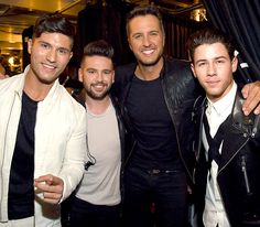Dan Smyers and Shay Mooney (of Dan + Shay) posed with ACM Awards co-host Luke Bryan and performer Nick Jonas at AT&T Stadium in Arlington, Texas, on April 19.