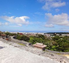 """""""The view from Shuri castle in Naha, Okinawa! Blog post up ➡ link in bio! #travel #instatravel #travelgram #travelling #travelbug #travelblog #travelwriter #blogger #travelphotography #travelblogger #wanderlust #wanderwithme #traveller #culture #nature #history #architecture #adventure #lifestyle #japan #okinawa #naha #summer #beach #sun #cityscape #castle #claire_hereandthere"""" by @claire_hereandthere (Claire   Here and There   🇦🇺). #turismo #instalife #ilove #madeinitaly #italytravel…"""