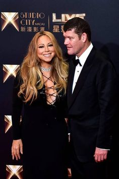 US singer Mariah Carey and co-chairman of Melco Crown Entertainment James Packer stand on the red carpet ahead of the opening ceremony of the Studio City casino resort in Macau. Is it all over?