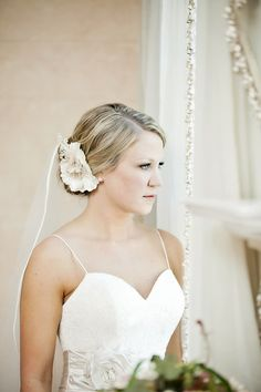 This floral hair accessory is a great addition to a side bun. Love! {Jacquie Rives Photography}