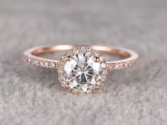 Moissanite Engagement ring,14K&18K Rose/Yellow/White Gold Available. Every Jewelry in my store needs making to order. The Engagement ring features a 7mm Round Cut Charles & Colvard Moissanite,diamond go half around the band.[Item details]Engagement Ring:Solid 14K Rose Gold(Can be made in white/yellow/rose gold)Band Width approx 1.3mmSize 5#(Ring can be resized)7mm Round cut 1.25ctw Charles & Colvard Moissanite0.26ctw Round Cut SI-H Natural Conflict ...