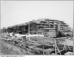 JLP01/01/041/11 View showing the construction of the Wall's ice cream factory production block taken from the north west. Wall's Ice Cream Factory, Gloucester, Gloucestershire. This image was catalogued in 2013 as part of a pilot project funded by the John Laing Charitable Trust. 23 Feb 1960. Walls Ice Cream, Historical Images, Gloucester, North West, Paris Skyline, Pilot, Trust, England, Construction
