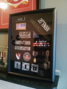 A velcro backed shadow box is an easy way to get patches, name tapes, and misc small items out of boxes and onto the mantle after military separation