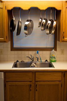 How to build a pots and pans storage rack cheaply that spans between two kitchen cabinets, and allows pans to be sideways