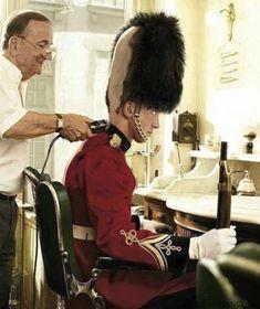 A Queens Guard getting his first haircut