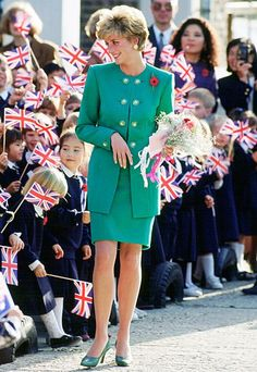 1992 | The princess visited the British School of Seoul in South Korea wearing a fitted green suit with matching pumps. | InStyle 15