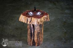 Rustic live edge cedar log stump bathroom vanity.