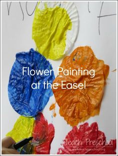 Flower Painting at the Easel by Teach Preschool
