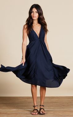 Maxi dress with deep v to neck and back. Drawstring ties to neck and bust so you can adjust to your body shape. Loose and flowing.