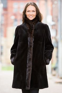 Graceful and warm is the the Paloma Mink Fur Coat. This versatile coat boasts silky-soft sheared mink fur on one side and water-repellent taffeta on the other.