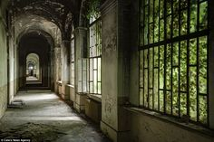 Here, the trees are slowly breaking their way through the windows of this corridor as the ...
