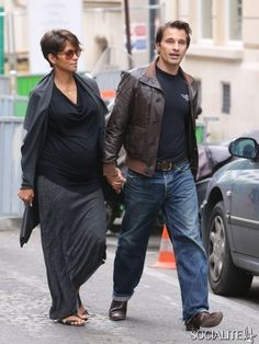 Pregnant actress Halle Berry and her fiance Olivier Martinez leave the Plaza Athenee and do some shopping along Avenue Montaigne in Paris, France on June 11, 2013.
