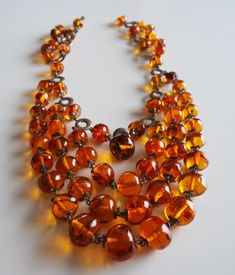 A lovely ladies art deco amber necklace in pristine condition. size of amber beads: from - to - Amber Necklace, Faux Pearl Necklace, Amber Jewelry, Beaded Necklace, Amber Resin, Amber Beads, Chunky Bead Necklaces, Chunky Jewelry, Flower Choker